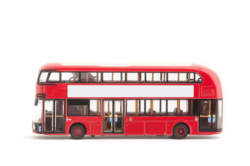 toy model red london bus on a white with copy-space