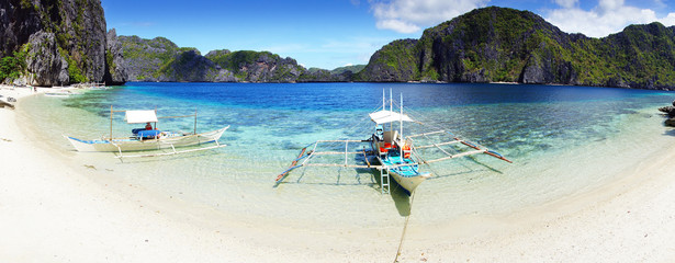 Boats on a beach at Snake Island. El Nido, Philippines