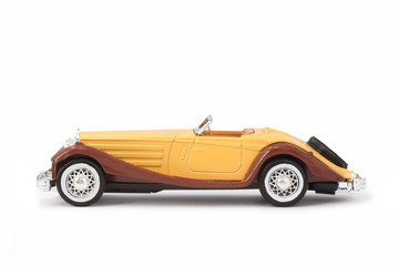 Wall Mural - vintage miniature model sports car on white