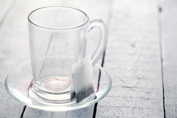 Empty glass with teabag