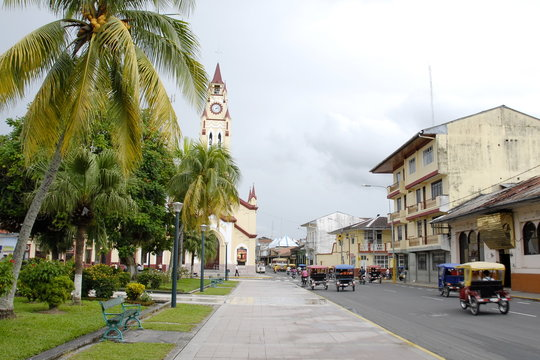 "Street near Plaza de Armas (""Weapons' Square"") in Iquitos, Peru."