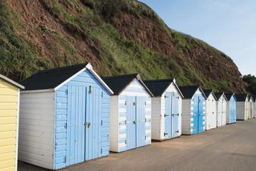 Colorful Beach Huts at Seaton, Devon, UK.