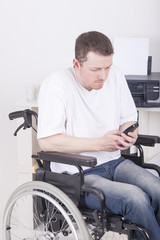 office worker in wheelchair having a phone call