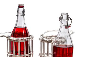 Closeup of red juice in bottles
