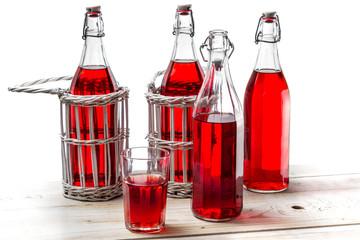 Vintage bottles with red juice