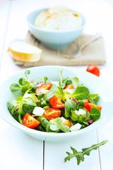 fresh salad with mozzarella, tomatoes and arugula