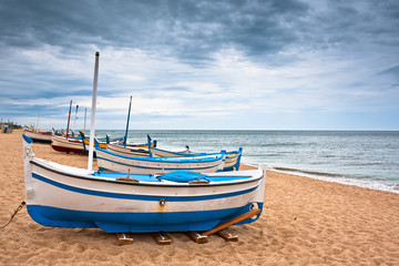 View of a boat in on a beach in Calella, Spain
