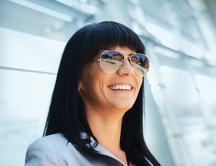 Portrait of attractive business woman outdoor over modern buildi