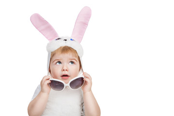 Boy with big blue eyes dressed in Easter bunny ears
