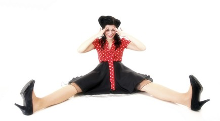 smiling pin up girl sitting on floor isolated