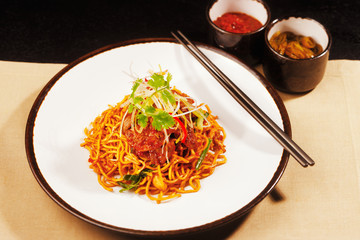 Vegetarian noodles with Szechwan sauce capsicum and spring onion
