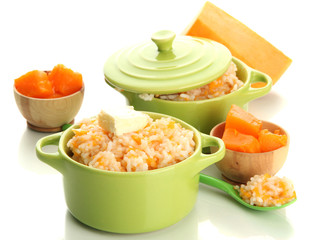 Taste rice porridge with pumpkin in saucepans, isolated