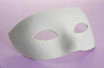 White mask, on purple background
