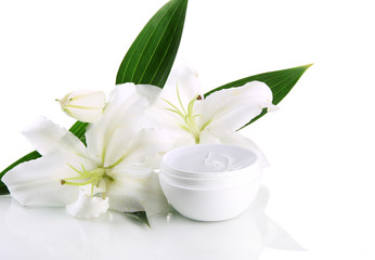 Cosmetic cream and beautiful lily, isolated on white