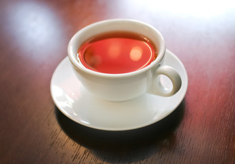 Cup of tea on wooden table, macro