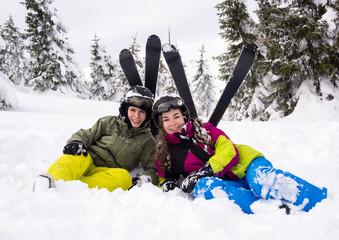 Teenage girl and boy skiing