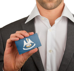 Businessman is holding a business card, Louisiana
