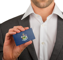 Businessman is holding a business card, Maine