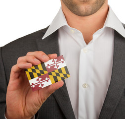 Businessman is holding a business card, Maryland