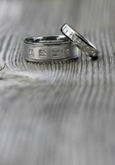 Two wedding rings on wood