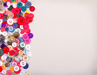 multi colored buttons on fabric