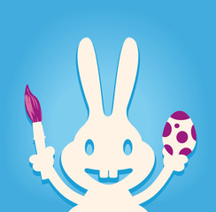 Osterhase mit Pinsel und Ei blauer Hintergrund