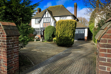 Mock Tudor house with drive