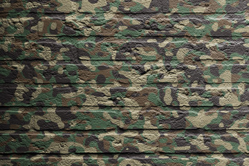 Brick wall with a painting of a flag, Camouflage