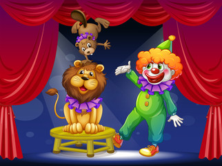 A clown with animals at the stage