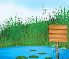 Fond de hotte en verre imprimé Papillons A pond with an empty signboard
