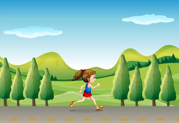 A girl jogging at the street with trees