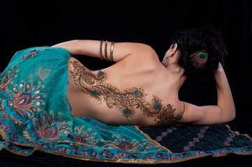 Peacock Feather Henna Design on a Woman's Back