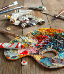 Palette with oil paint and palette-knife.