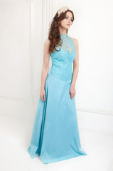 The young woman in blue evening dress