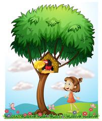 Keuken foto achterwand Vlinders A girl in the garden with a bird in a bird house