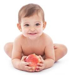 Happy baby with a big apple in her hands.