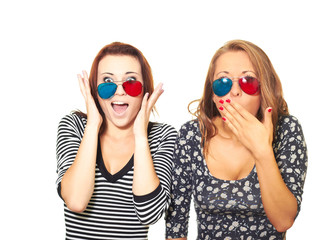 Two attractive girls surprised the 3D glasses.