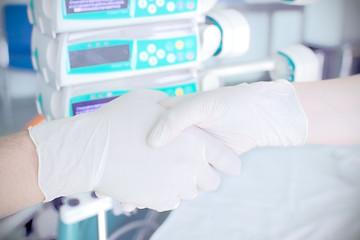 Handshake in the laboratory.