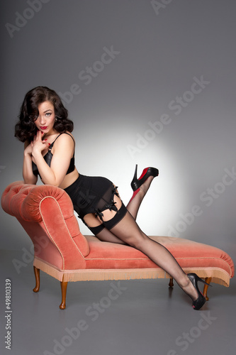 a0f3fc208 Attractive classic fifties pinup in black lingerie   stockings ...