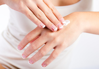 Papiers peints Manicure Body care. Woman applying cream on hands