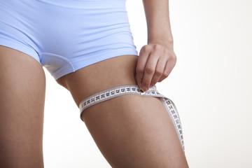 Woman measuring her leg