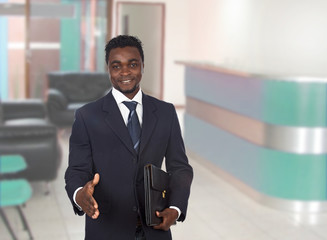 Happy businessman extending his hand for greeting