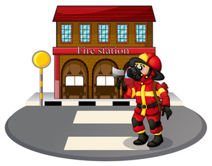 A fireman in front of the fire station