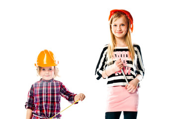 Two young beautiful girls in building helmet and tools in hand