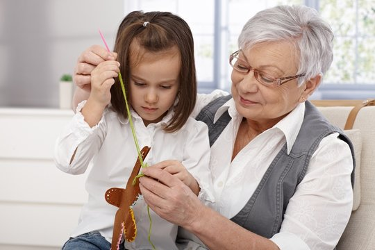 Granny and granddaughter sewing