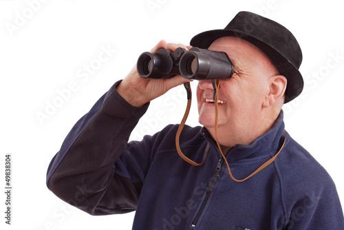 homme qui observe avec une paire de jumelles sur fond blanc photo libre de droits sur la. Black Bedroom Furniture Sets. Home Design Ideas