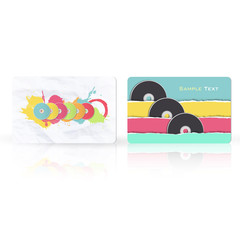 Colorful CDs inside a business card.
