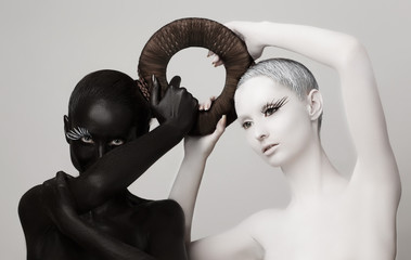 Yin & Yang Esoteric Symbol. Black & White Women Silhouettes