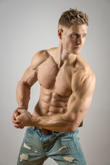 Abdominal muscle of blond athletic man