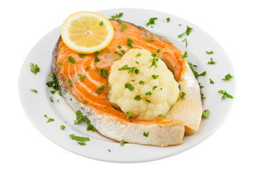 salmon with cauliflower on the plate on white background